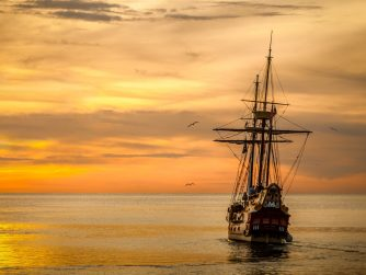 tall ship going into the sunset