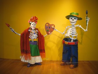 Day of the dead mannequins - a male and female skeleton who are artists