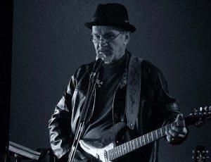 Allan Wilson playing guitar.