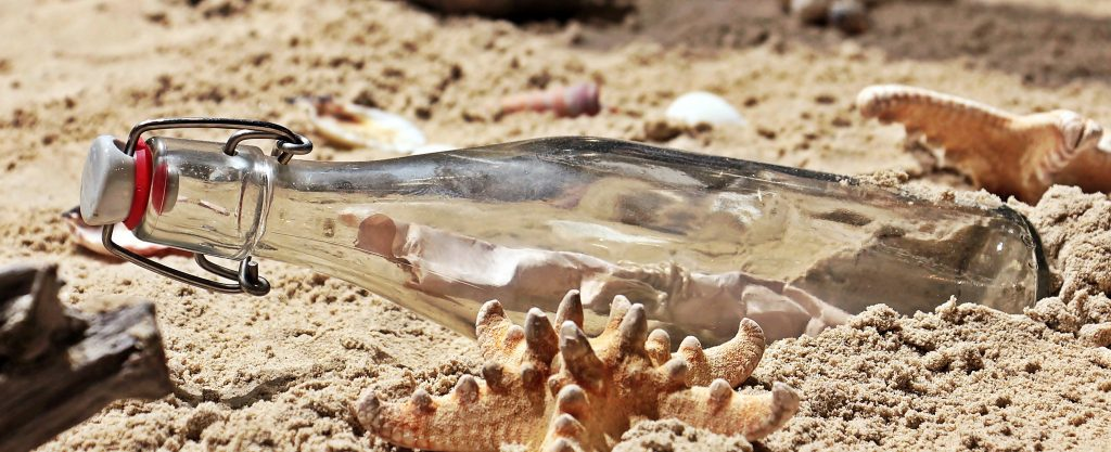 Message in a bottle on the sand.