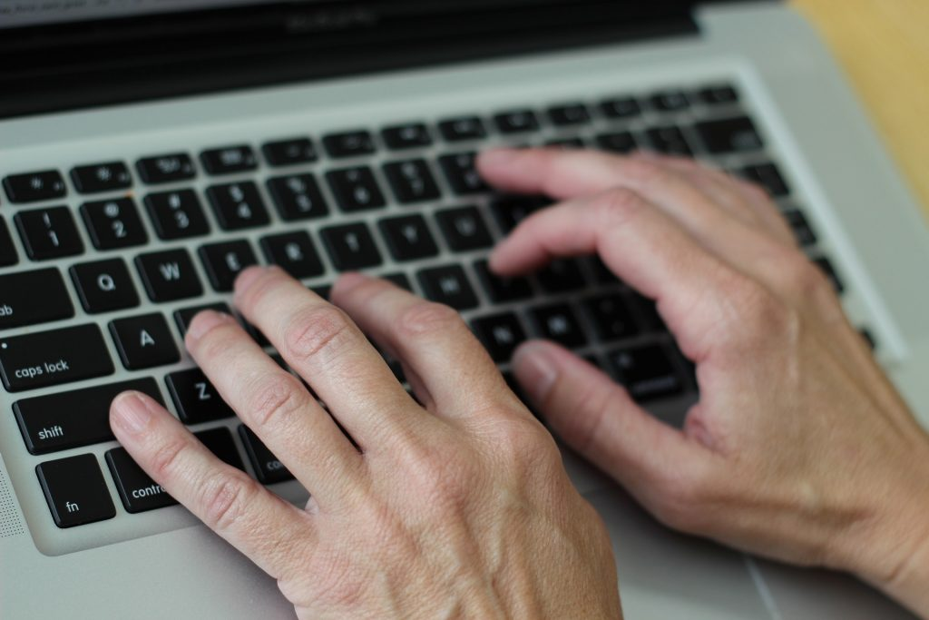 Person Typing.  Image by Victoria Loveland